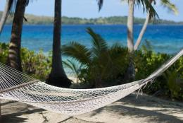 Beautiful scenic background of an empty hammock at a tropical beach 275