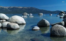 White rocks piling up in a calm lake wallpaper 381