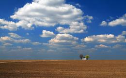 building among the plowed field wallpapers and imageswallpapers 1231
