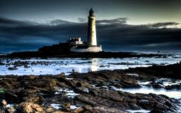 Wonderful lighthouse on a rocky shore wallpaper 1215