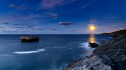 Lighthouse On A Rocky Shore Shining A Green Light Hd Desktop 1630