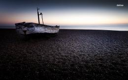 Small wooden boat on the beach wallpaperPhotography wallpapers 365