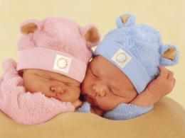 two little sleeping babiesOne with pink and one with blue clothes 338