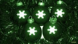Green Christmas decoration and balls with big white snow flakes 350