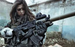 Girl with gun Wallpapers Pictures Photos Images 1705