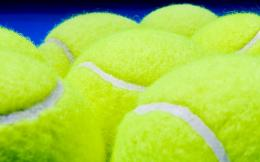Sports wallpaper with yellow tennis balls on a blue background 889