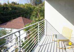 On the balcony off the master bedroom is a yellow Hatfield Grellow 391