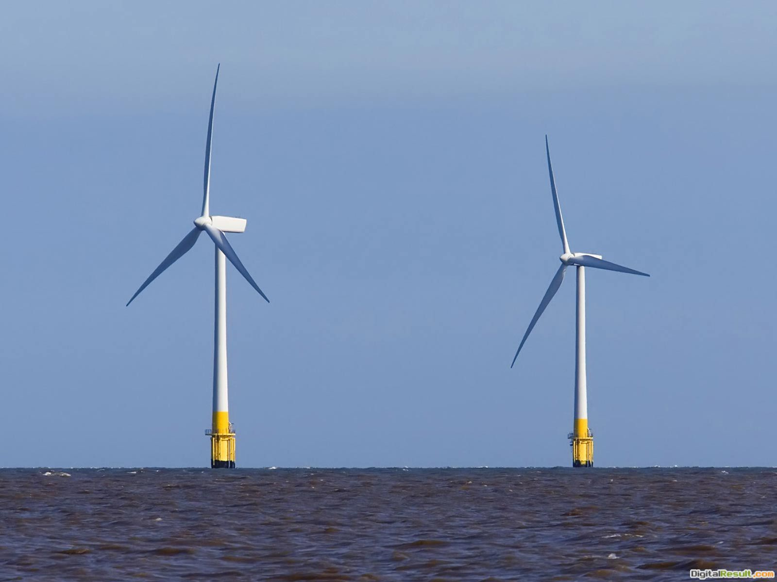 Desktop Wallpaper of a two large wind turbines in the sea off the UK 1529